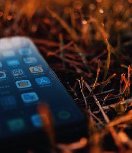 black iphone 4 on brown dried leaves